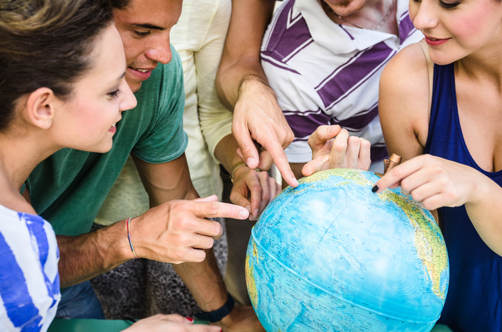 students searching place on a globe